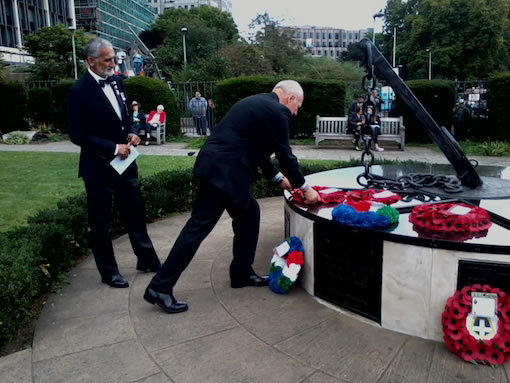 Mike-Bowles-laying-wreath-watched